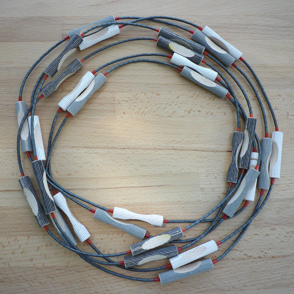 New design for a necklace made of wood