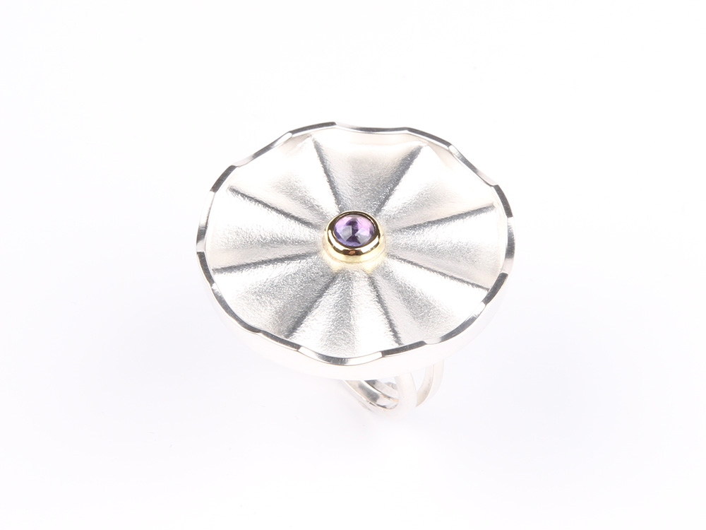 I like to introduce Flower our latest ring
