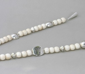 Long necklace with white antique beads