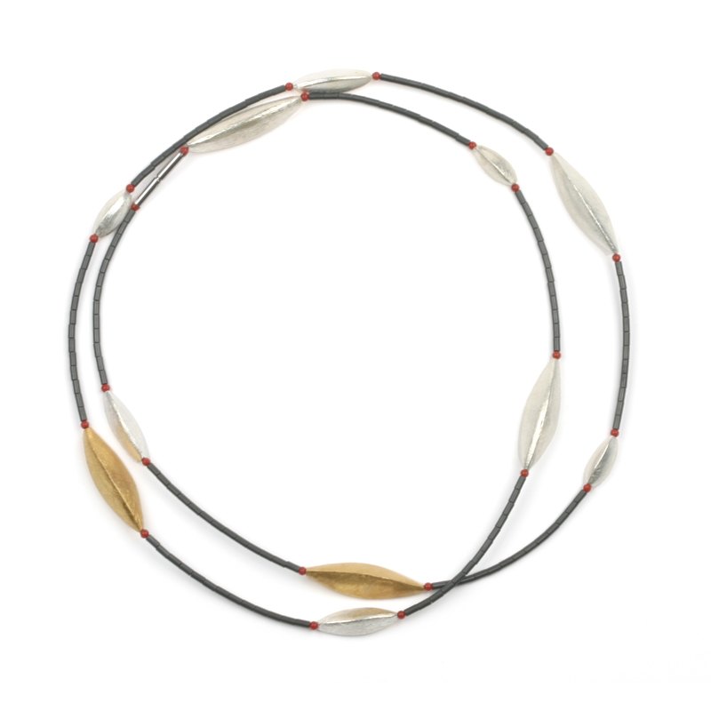 long handmade necklace in silver and gold