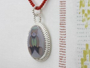 Ceramic pendant in sterling silver bead wire