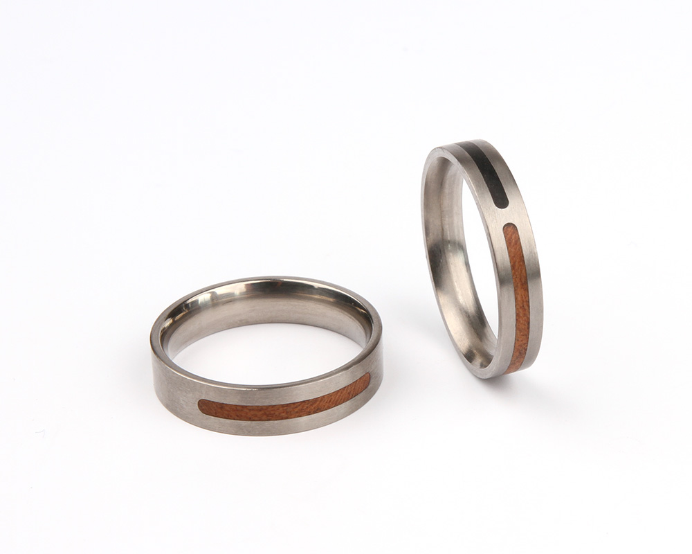 Wedding bands FOREVER in titanium withebony