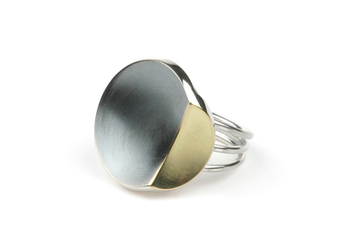 Silver ring with 18 karat gold
