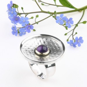 Large silver ring with a deep purple amethyst