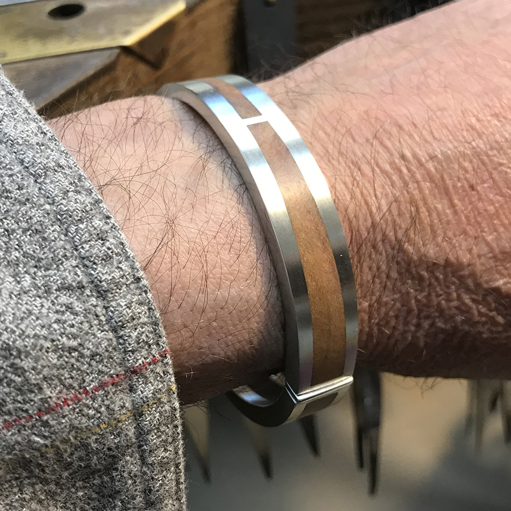 Silver bracelet with cherry wood inlay