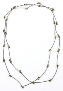 Long silver necklace with hoops of gold