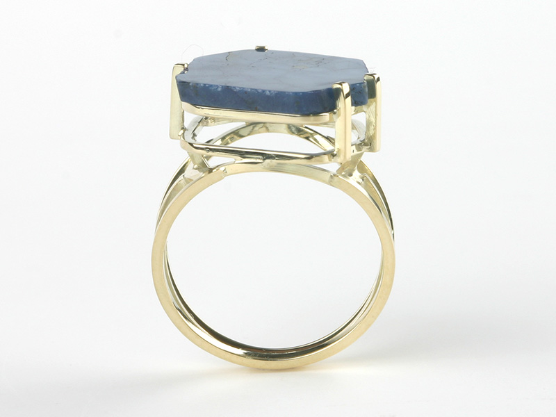 Golden ring with blue sapphire