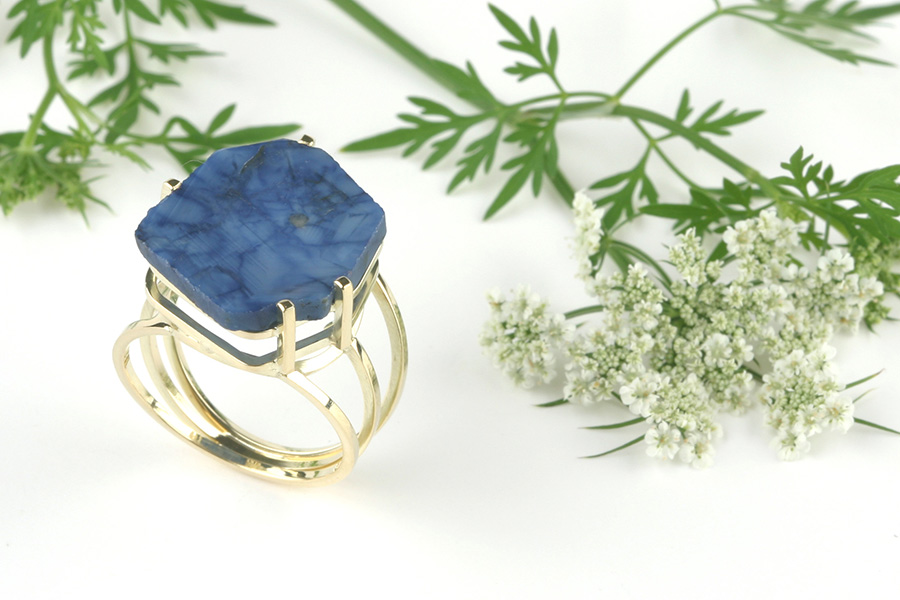 Golden ring with sapphire