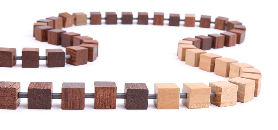 Hip to be Square A long necklace made of wood