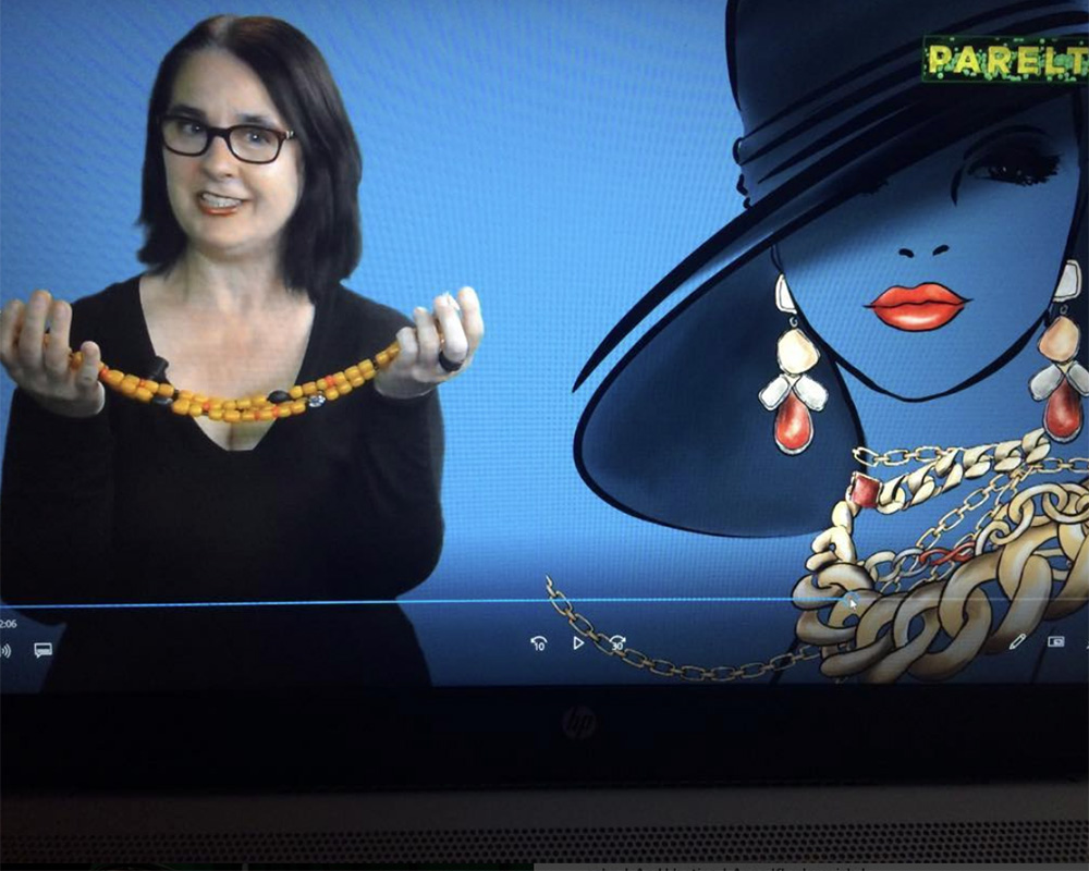 Myra Winter shows The Jewelry Story's necklace in a tv programme