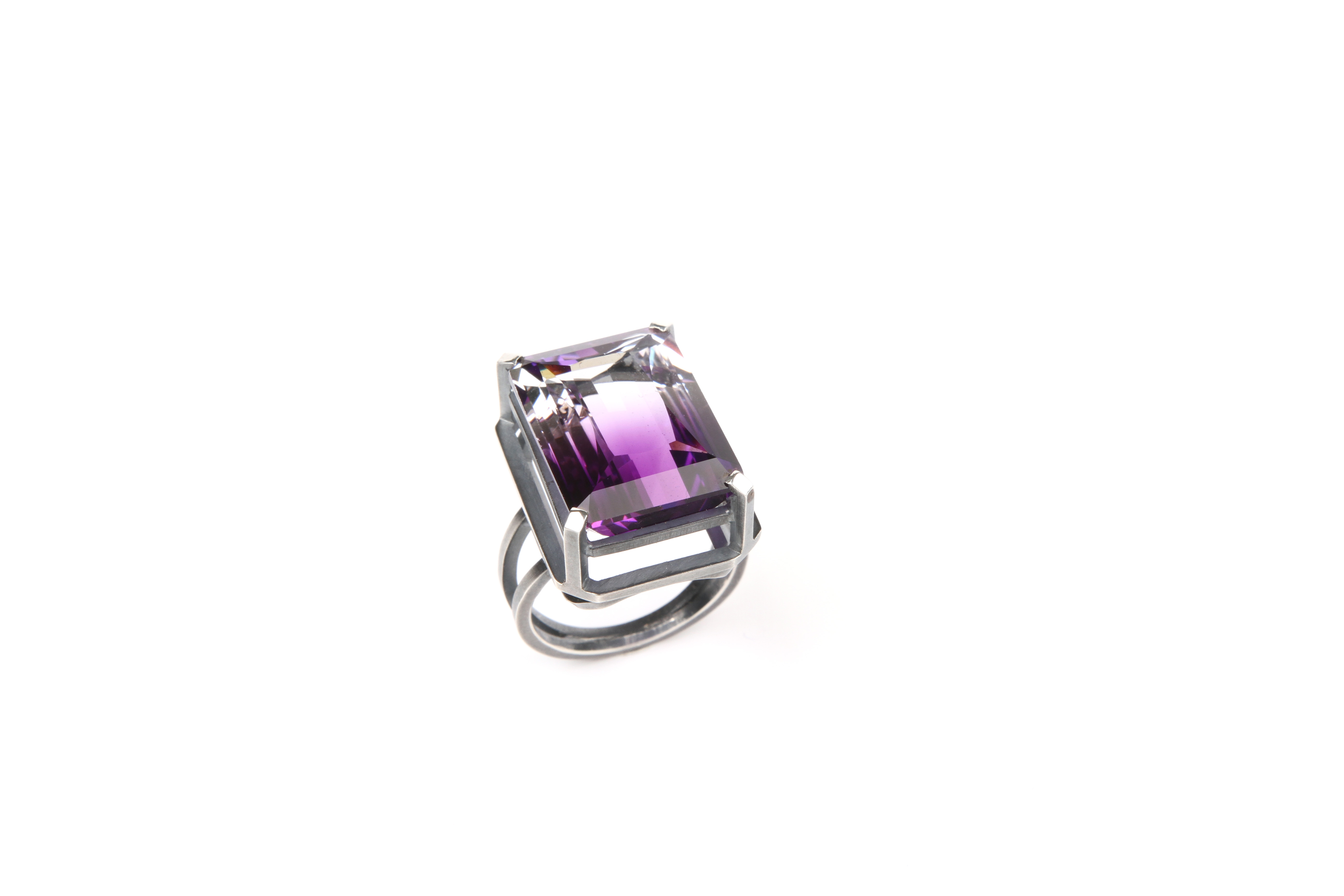 Silver ring (blackened) with a purple stone
