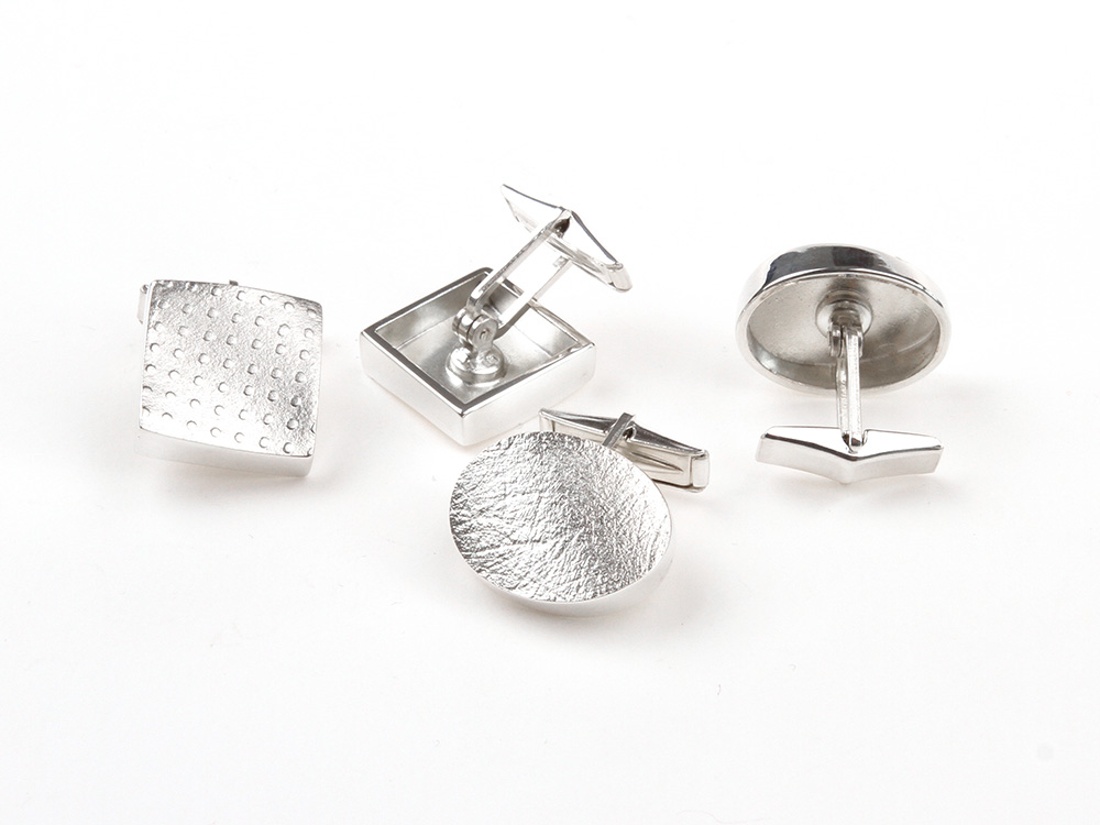 Silver cufflinks seen at the back