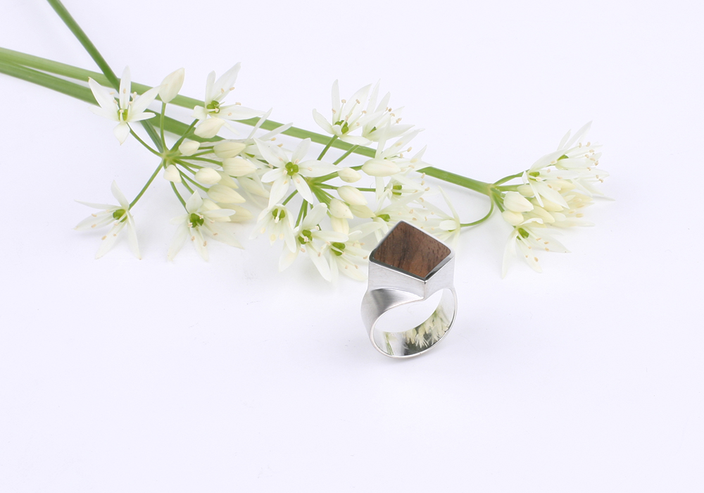Silver mens ring in diamond shape with ebony inlay