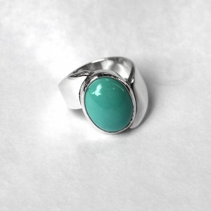 A ring with a genuine non treated turquoise stone