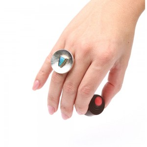 Large silver ring with a blue opal