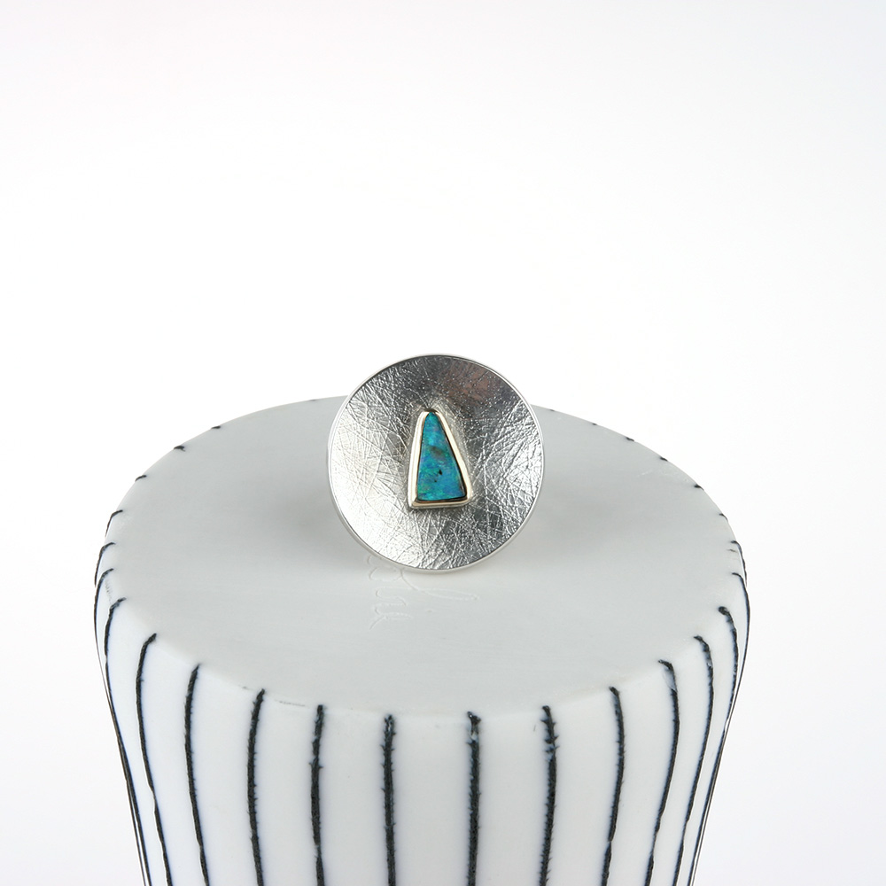Large silver ring with blue opal