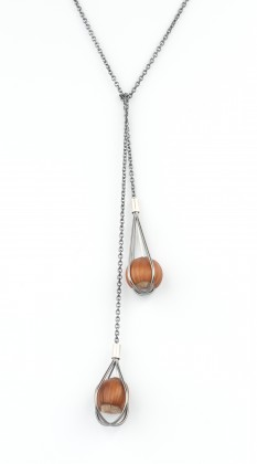 Trapped Hazelnuts, a long silver necklace