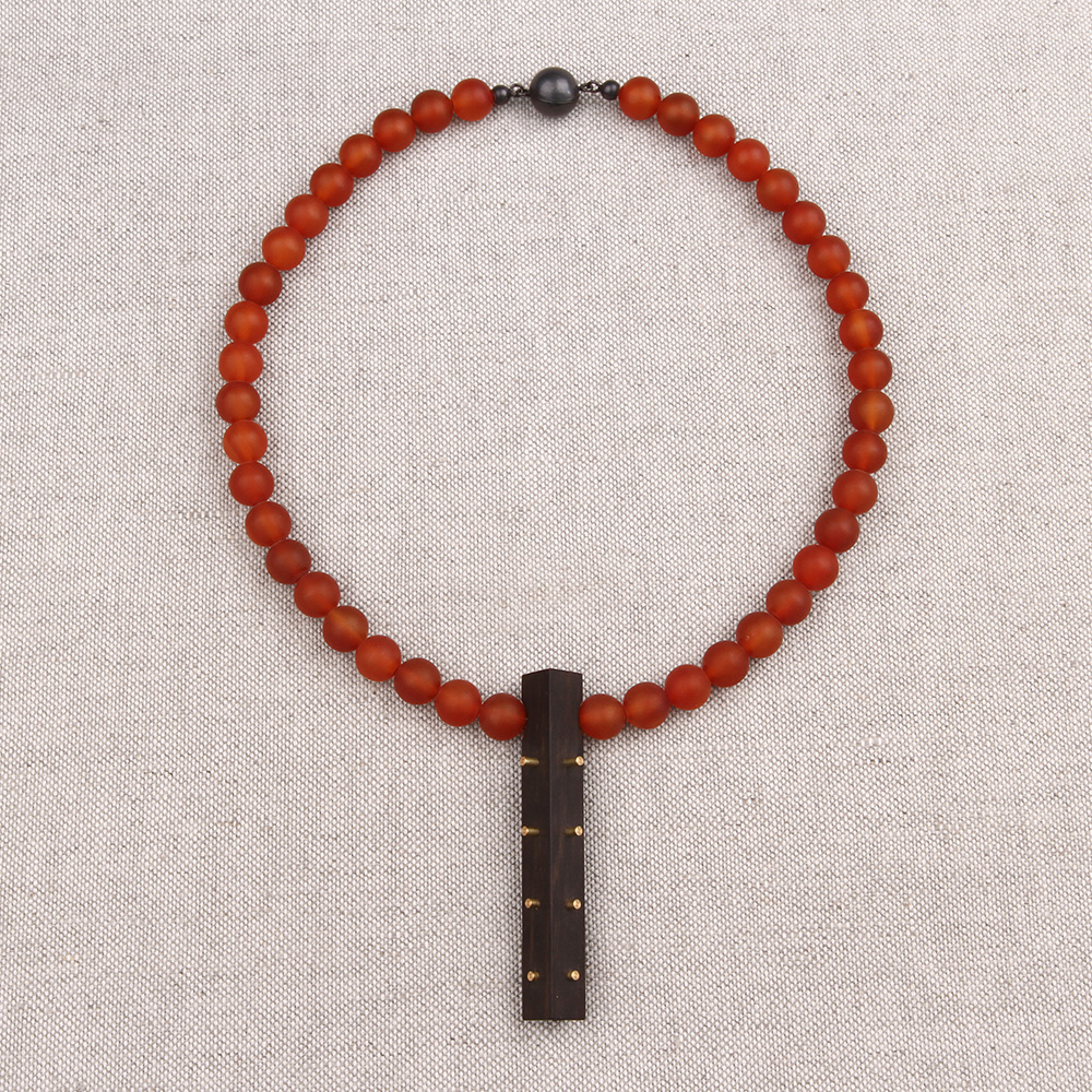 Necklace made of carnelian and a ebony pendant