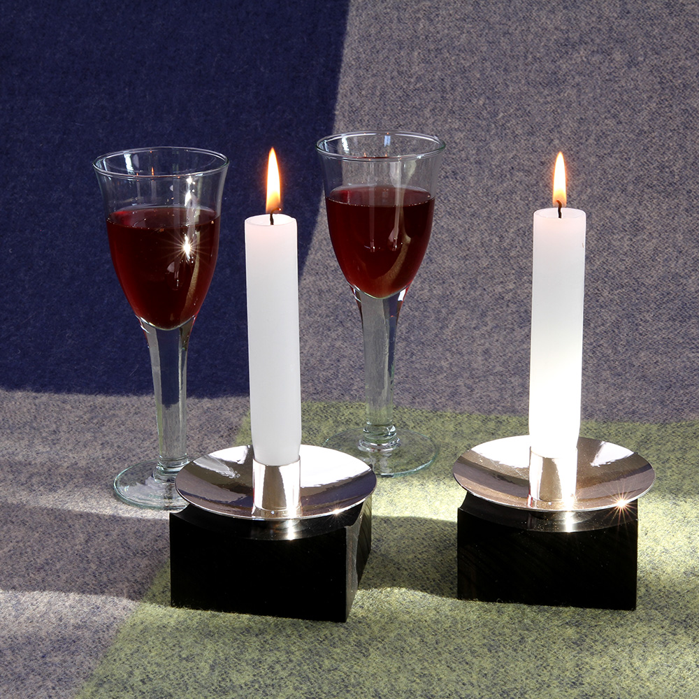 Candle holders made of silver and ebony