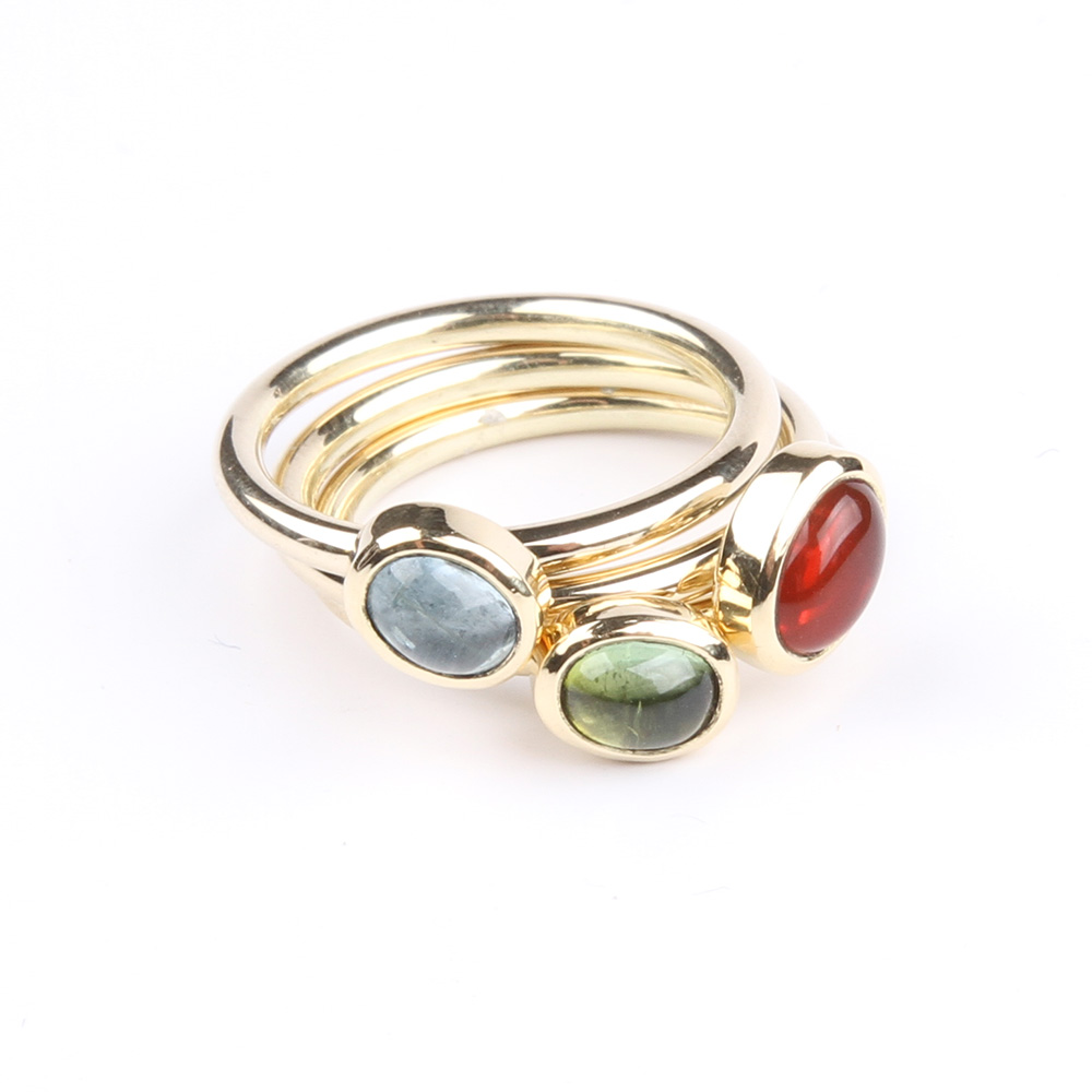 Gold ring with aquamarine, fire opal and a tourmaline