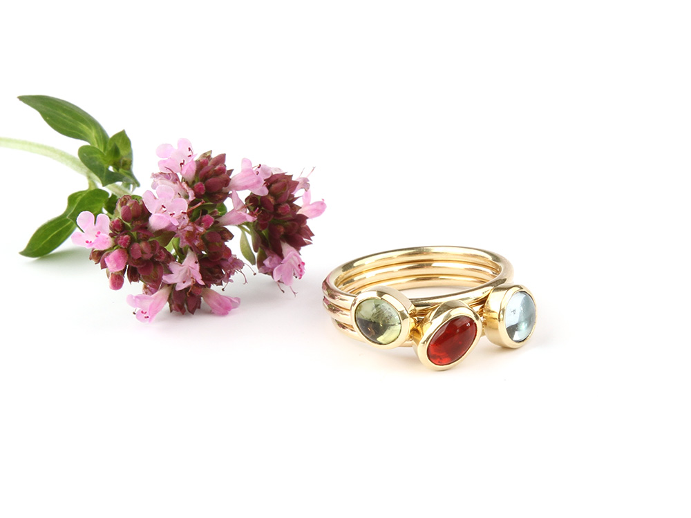 Ring with tourmaline, aquamarine and fire opal