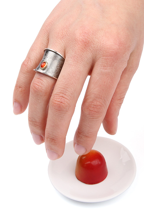 Wide black ring with fire opal
