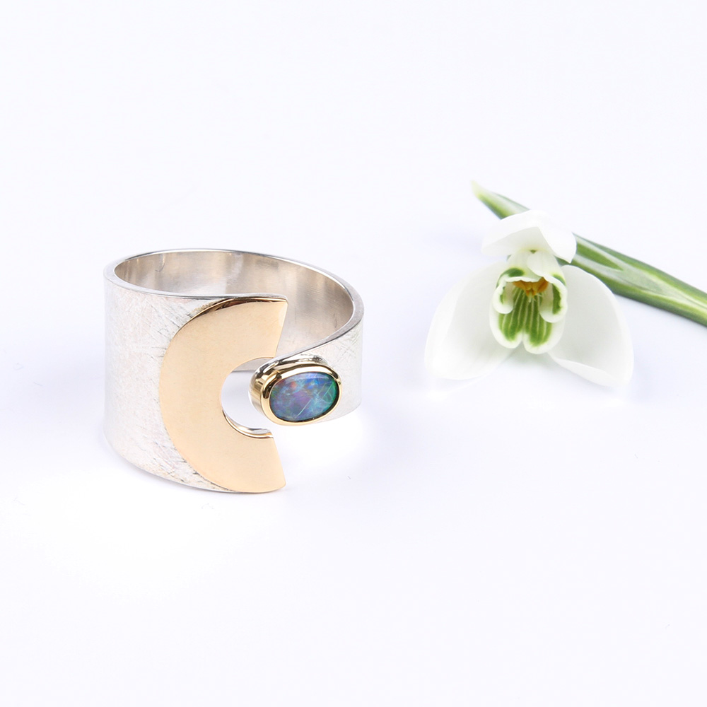 Silver and gold ring with Boulder opal