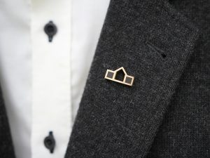 Small lapel pin in gold or silver called Home