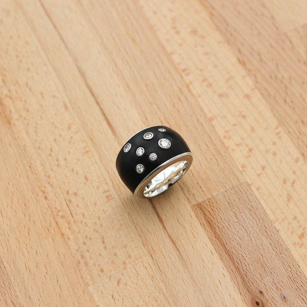 Silver ring with ebony and diamonds