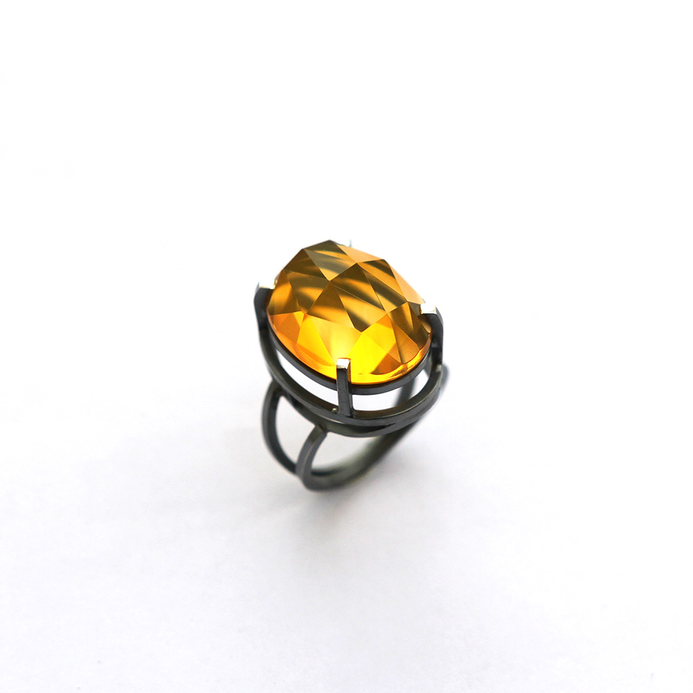 Big silver ring with a fire opal