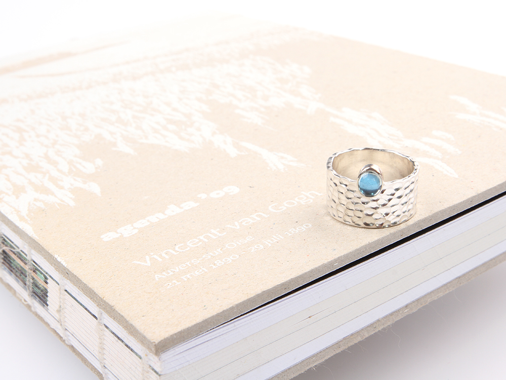 Wide silver ring with aquamarine