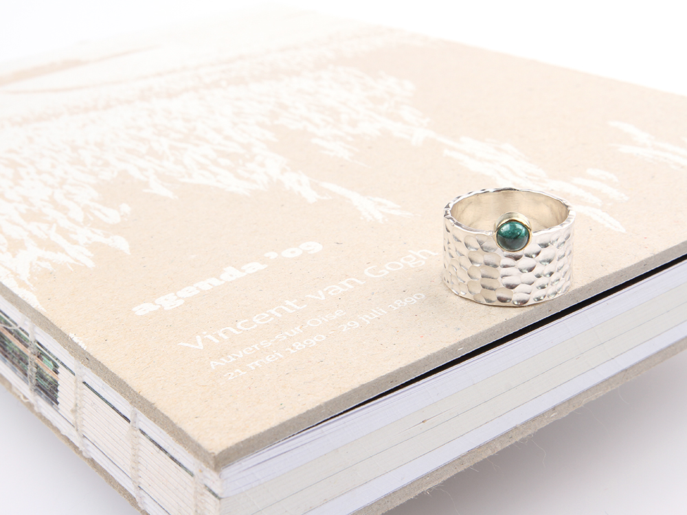 Wide silver ring with green tourmaline