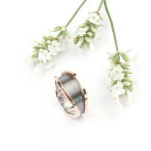 Wide silver ring with red gold