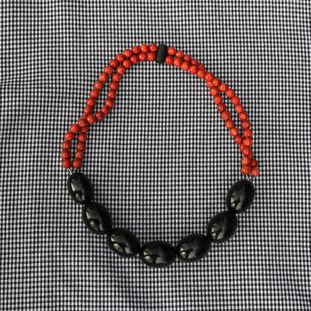 Necklace made of jet beads and apple coral