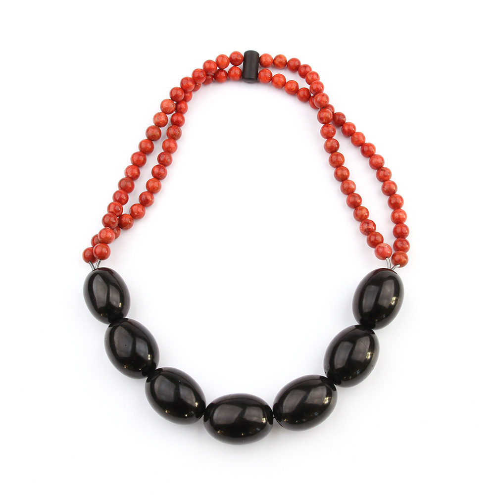 Necklace made of jet and apple coral