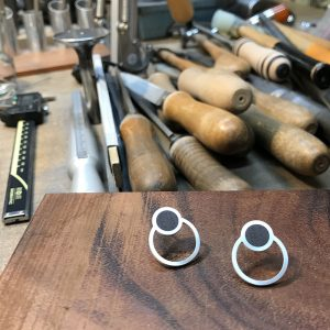 Round silver earrings with wood
