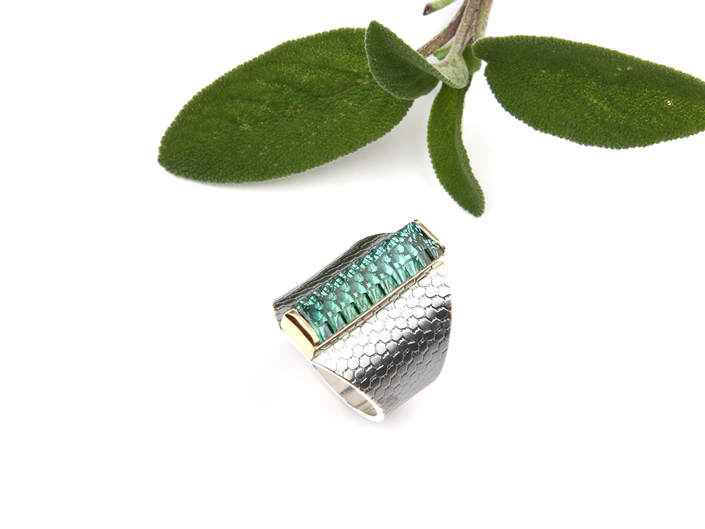 Silver ring with a green tourmaline