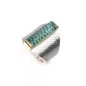 Wide silver ring with a big green tourmaline