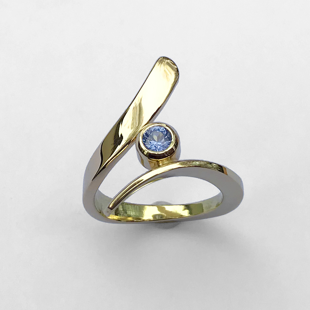 A gold ring with a blue sapphire