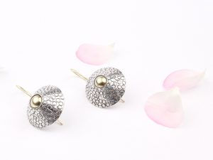 Long cone shaped silver earrings